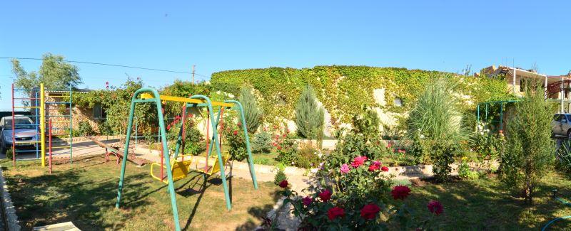 Детская площадка на территории отеля Ксюша